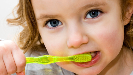 Girl-Brushing-Her-Teeth
